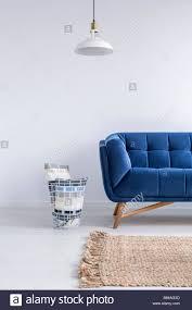 Image Decorating Ideas White Minimalist Room With Blue Sofa Lamp And Rug Alamy White Minimalist Room With Blue Sofa Lamp And Rug Stock Photo