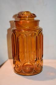 here for is a vintage amber glass cookie jar this piece is very thick and weighty and definitely has lots of age to it possibly as far back as