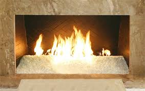 alpine nugget diamond fire pit glass installed in an indoor fireplace