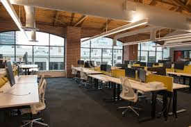 office natural light. trendy modern open concept loft office space with big windows, natural light and a layout to encourage collaboration, creativity innovation c