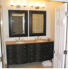 Bathroom. black wooden Bathroom Double Vanity with brown wooden top and  double round white sink