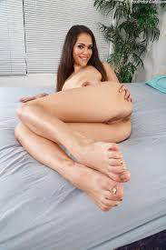 Leilani Gold gives a footjob and gets her shaved pussy fucked.