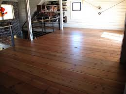 wide plank floors and horizontal white planked walls