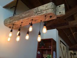 huge rustic industrial chandelier with reclaimed wood beam