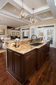 kitchen sink lighting ideas. Interior. Two Chandeliers Pendant Lamps Over Brown Granite Kitchen Islands Top With Black Sink Added Lighting Ideas A