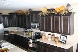 decorate above kitchen cabinets