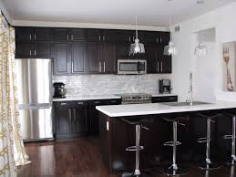 Kitchen with dark cabinets and white quartz counters AND MARBLE BACKSPLASH  | Cul da Sac Cruz | Pinterest | Quartz counter, White quartz and Dark