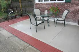 patio pavers. Extending A Poured Cement Patio With Sixteen Inch Square Brick-face Stepping Stone/ Pavers U