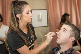 the author seated gets made up photo by thomas garza a new makeup artist