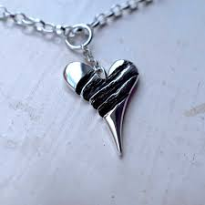 clawed heart pendant