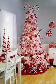 whimsy wwhite tree with red and white decorations and ornaments