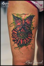 татуировка бабочки и цветка на ноге женская цветная татуировка