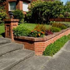 Small Picture Rock Fence Designs Curved brick retaining wall with front yard