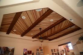 a home s real wood plank ceiling enhanced with faux timber beams