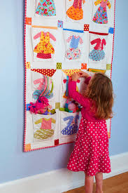 Hanging Pocket Organizer ~ the happy zombie ~ tut on all people ... & pocket quilt - cute idea for kids or. If you made it tiny and put it in the  office as an organizer Adamdwight.com