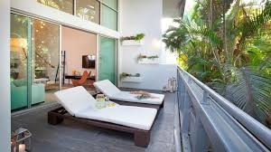 exteriorawesome apartment balcony ideas with rattan furniture sets plus white pad also tables plus balcony design furniture