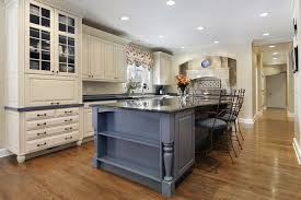 Wonderful Upscale Kitchen With Offwhite Cabinets And Large Granite Island