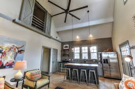 vaulted kitchen and open loft