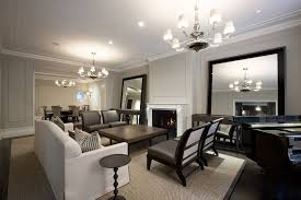 hanging heavy mirror on drywall contemporary living room also accent table area rug brown leather chandeliers chrome crown molding dark stained wood