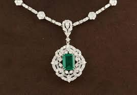 a stunning green emerald and diamond necklace in a classic design 1 84 carat gia certified