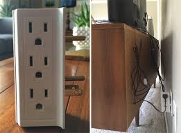use a multiple prong outlet and zip ties to hide cords behind a TV console (