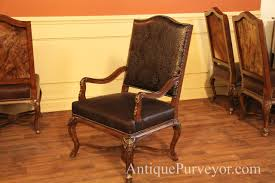 luxury brown hide hair arm chair with black fl embossed leather and silver black nail trim
