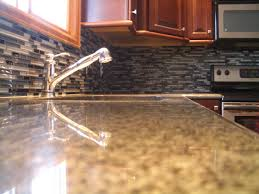nice zoom of contemporary tile backsplash with great design and glossy silver faucet under glass it
