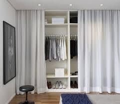 Hidden Closet Bedroom With Curtain Decor