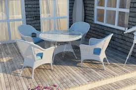 white wicker circular dining table set
