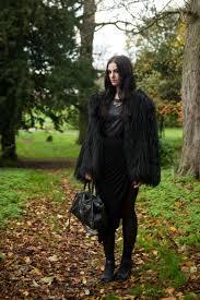 fashion blogger stephanie of faiiint wearing lookbook faux fur black longhaired coat