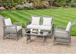 this rolled rattan effect sofa set is perfect to add country chic to your garden the set comprises a two seat sofa two armchairs and a coffee table