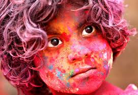 holi the n spring festival of colors kicks into high gear an n child face smeared colored powder celebrates holi festival in mumbai