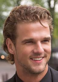mens with short curly hairstyles brushed back wavy hairstyle