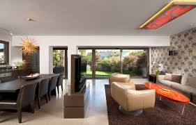 Trendy open concept living room photo in Other with a wall-mounted tv