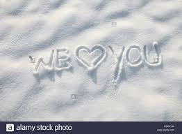 Heart In The Snow We Love You Word Message On The Snow Stock Photo