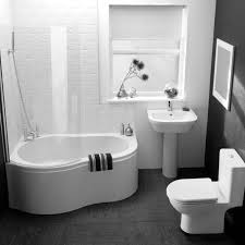 modern toilet and small pedestal sink with small bathtubs plus bathtub shower combo and glass enclosure