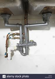 Waste Pipe And Fittings Under A Double Kitchen Sink And Earth