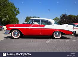 Side view of a parked red and white 1956 Chevrolet Belair 4-door ...