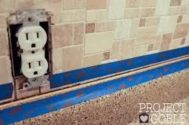 caulking kitchen backsplash. Grouting The Edges Of Our Peel And Stick Instant Mosaic Kitchen Backsplash Caulking I
