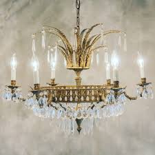 we did make two lighting design decisions this week left the pendants we bought from west elm for our kitchen island right a gorgoues 1920s chandelier