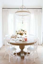 off white dining room chairs for sale. white dining room with beaded chandelier. christmas kitchen table off chairs for sale