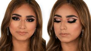 in today s video i m showing you how to create a dramatic glam makeup look with a bold graphic winged eyeliner big lashes and tons of sparkle