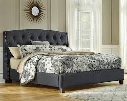 Signature Design by Ashley Kasidon Queen Upholstered Bed in Dark