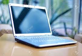 laptop office desk. Stock Photo - Thin Laptop On Office Desk T