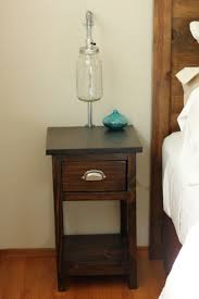 Bedroom. square dark brown wooden Bedside Table with single brown wooden  drawer and shelf with