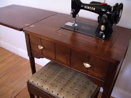antique Singer sewing machine and cabinet dream home