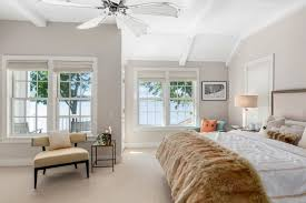 The Master Suite Offers Kingu0027s Bed With A Carpet Flooring Along With  Multiple Glass Windows.