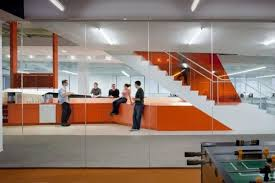 office orange. In Particular, Fosters A Hive Of Activity. Upon Their Descent,  Employees Arrive At Coffee Bar, Which Spans Th...- Orange Accents Office