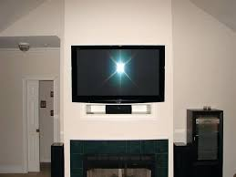 on fireplace mantel where to put cable box ideas tv shelf articulating wall mount with mounted