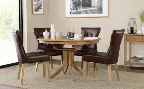 gallery hudson round oak extending dining table with 4 bewley club brown chairs